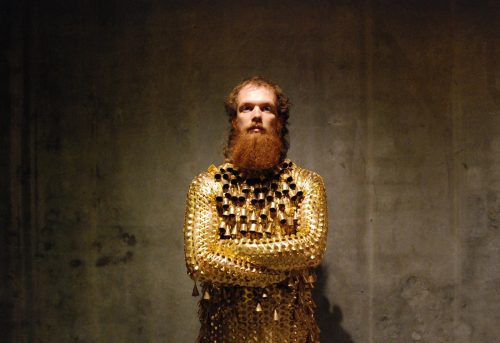 Photo of Taneli Törmä in Sophie Bellin-Hansen's bell-covered costume, for the second section of the triptych COVER