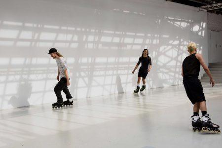 Rollerblading performers of Alex Baczynski-Jenkins's Us Swerve