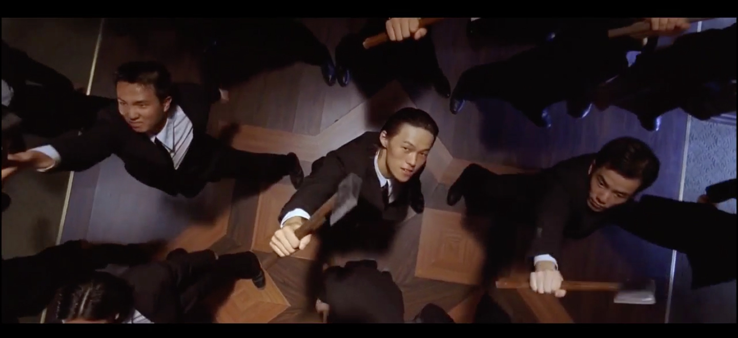 Brother Sam (Kwok-kwan Chan) and the Axe Gang take the floor in Stephen Chow's Kung Fu Hustle (2004)