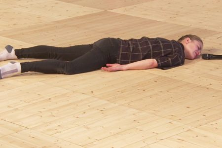 Woman on floor with microphone at POST-DANCE-ING 2019 conference, Stockholm