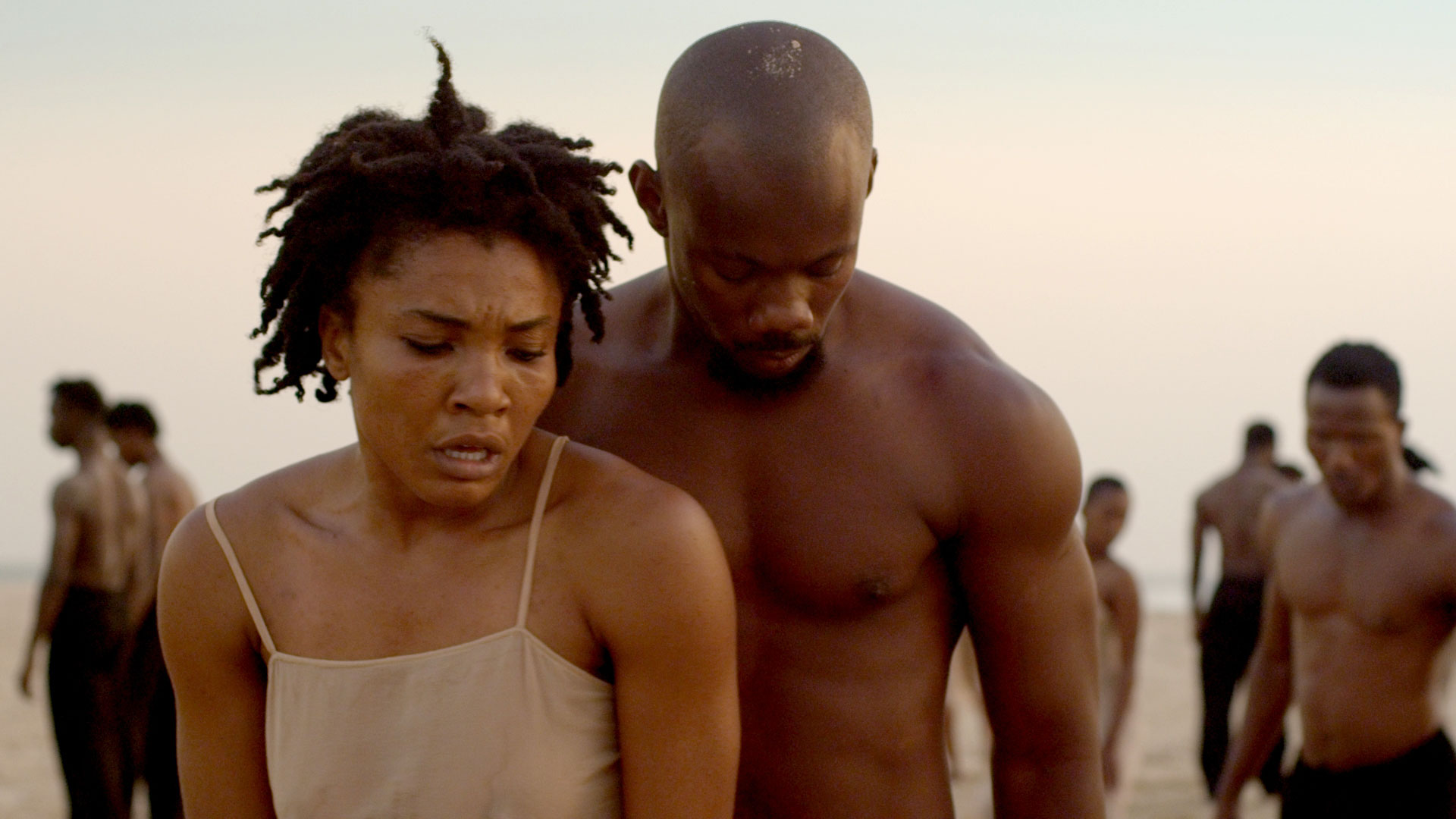 Gloria Biachi and Serge Arthur Dodoc in Bausch's Rite of Spring, captured on a beach in Senegal