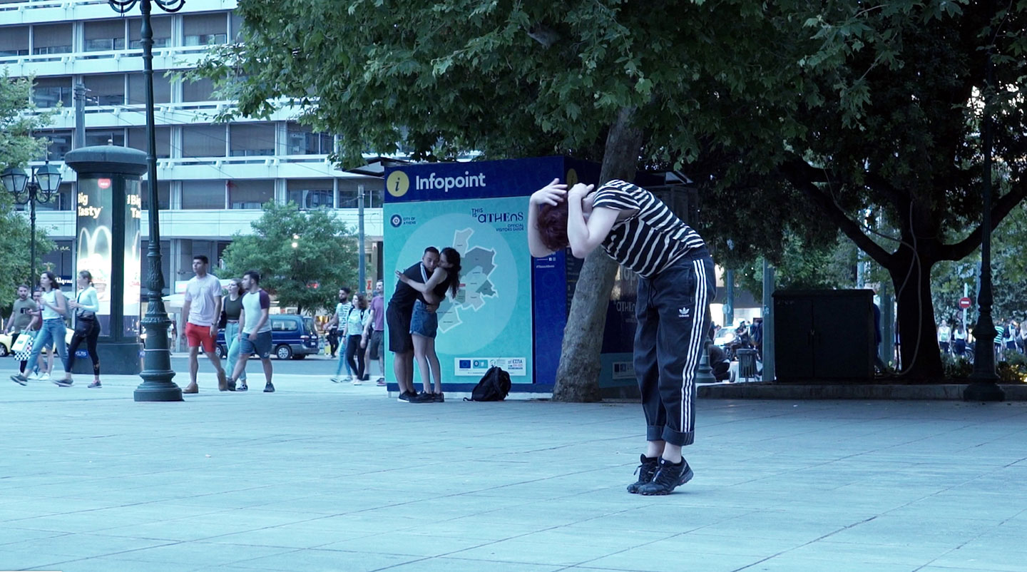 Woman dancing in 'The Crater', a performance practice in Athens, 2020