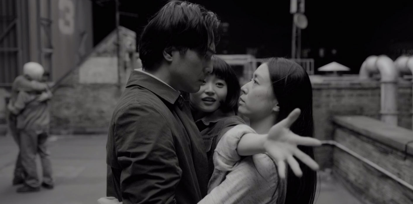 A moment from the rooftop dance scene in the final episode of Giri/Haji