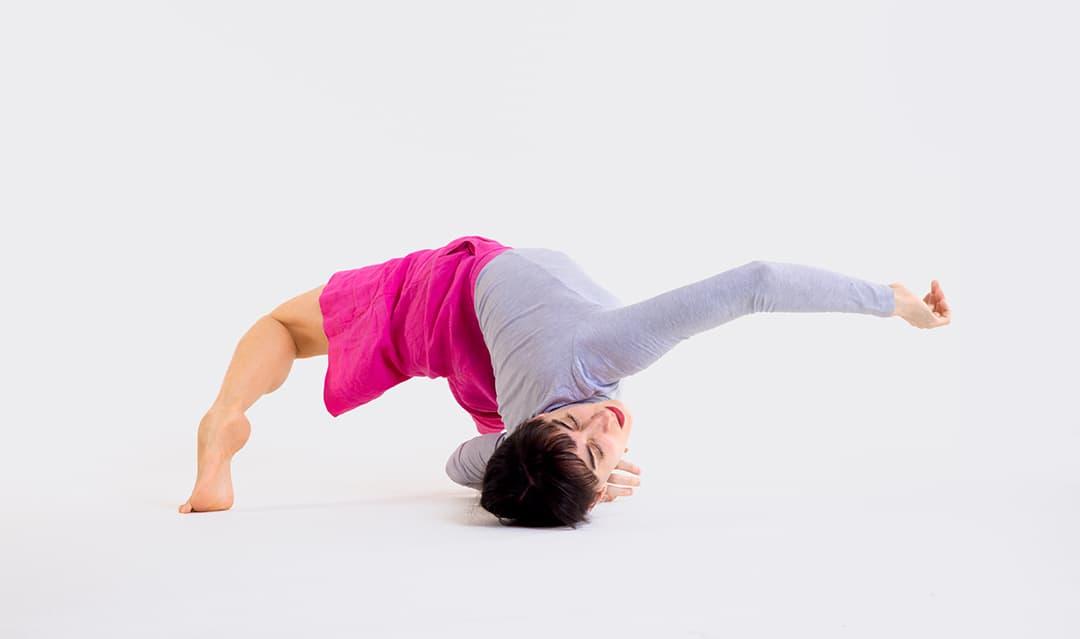 Dancer Mathilde Gilhet in a corkscrew position on the floor