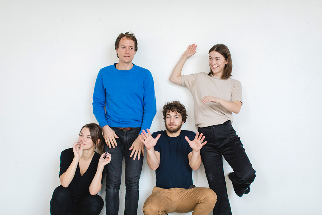 Ingrid Bergher Myhre with dancers Pablo Esbert, Chloe Chignell and Thomas Bîrzan, against wall, in various different gestural positions